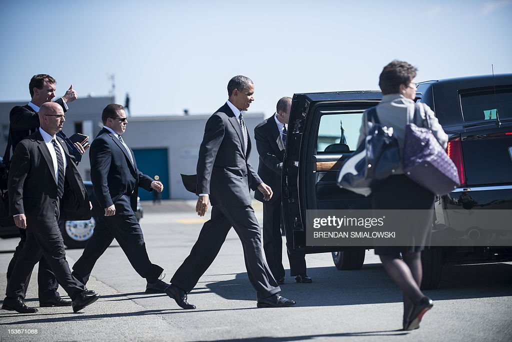 US President Barack Obama arrives at San Francisco International Airport on October 8, 2012. Obama is on a three-day trip during which he will campaign in California and Ohio as well as attend the establishment of the Cesar Chavez National Monument. AFP PHOTO/Brendan SMIALOWSKI