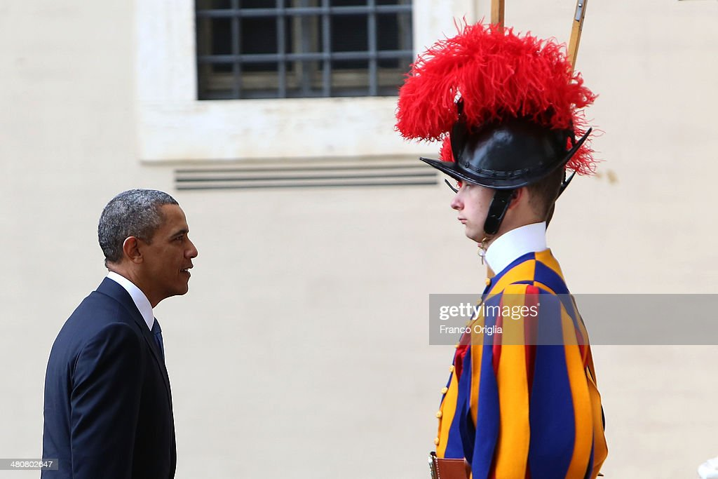 US President <a gi-track='captionPersonalityLinkClicked' href=/galleries/search?phrase=Barack+Obama&family=editorial&specificpeople=203260 ng-click='$event.stopPropagation()'>Barack Obama</a> arrives at the San Damaso courtyard in front of a Swiss Guard for a meeting with Pope Francis on March 27, 2014 in Vatican City, Vatican. Obama is attending his first audience with Pope Francis which is also his second time being received at the Vatican, after an audience with Pope Benedict XVI on July 10, 2009. <a gi-track='captionPersonalityLinkClicked' href=/galleries/search?phrase=Barack+Obama&family=editorial&specificpeople=203260 ng-click='$event.stopPropagation()'>Barack Obama</a> is the ninth US President to make an official visit to the Vatican. President Woodrow Wilson was the first US President who was received by Pope Benedict XV after the end of the First World War.