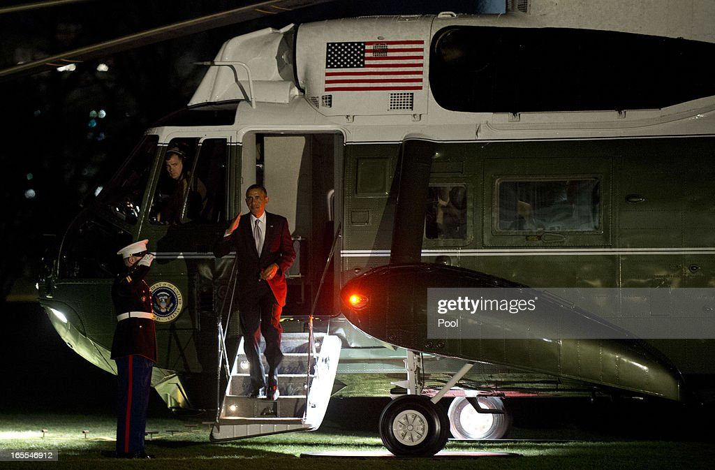 U.S. President <a gi-track='captionPersonalityLinkClicked' href=/galleries/search?phrase=Barack+Obama&family=editorial&specificpeople=203260 ng-click='$event.stopPropagation()'>Barack Obama</a> arrives at the White House April 4, 2013 in Washington, D.C. The president was returning from a trip to Denver and San Francisco.