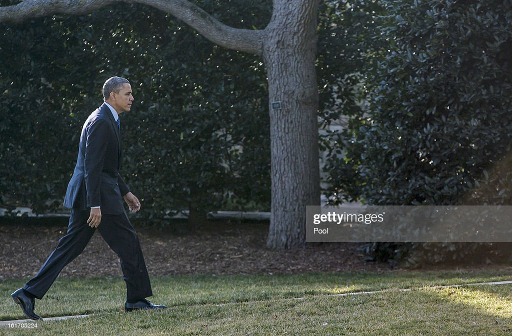 U.S. President <a gi-track='captionPersonalityLinkClicked' href=/galleries/search?phrase=Barack+Obama&family=editorial&specificpeople=203260 ng-click='$event.stopPropagation()'>Barack Obama</a> arrives at the White House February 14, 2013 in Washington, DC. Obama was returning after a trip to Decatur, Georgia to tout his pre-school initiative.