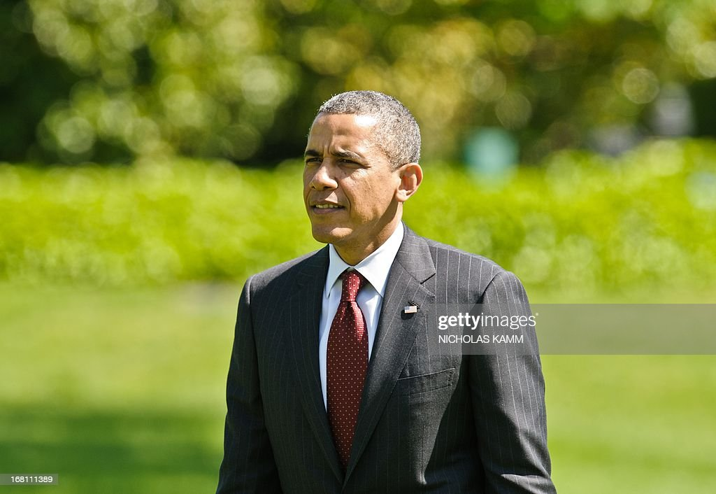 US President Barack Obama arrives at the White House in Washington on May 5, 2013 upon his return from Columbus, Ohio, where he delivered the commencement address at Ohio State University. AFP PHOTO/Nicholas KAMM