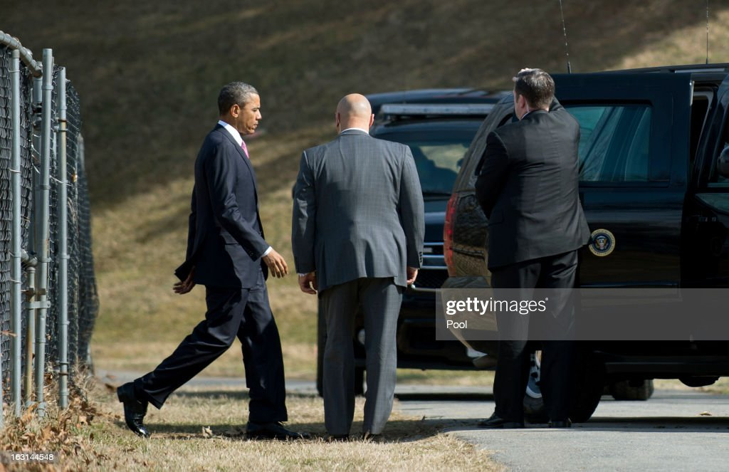 U.S. President Barack Obama arrives at Walter Reed National Military Medical Center to visit wounded military personnel on March 5, 2013 in Bethesda, Maryland. Later today Obama and Vice President Biden will meet with newly instated Defense Secretary Chuck Hagel in the Oval Office.