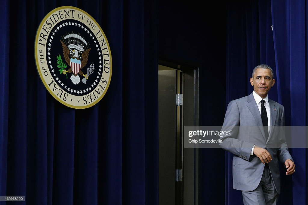 U.S. President <a gi-track='captionPersonalityLinkClicked' href=/galleries/search?phrase=Barack+Obama&family=editorial&specificpeople=203260 ng-click='$event.stopPropagation()'>Barack Obama</a> arrives before signing an executive order that requires government contractors to make public previous labor law violations and give their workers more rights to address disputes in the Eisenhower Executive Office Building July 31, 2014 in Washington, DC. Obama signed the labor order a day after House Republicans voted to go forward with a lawsuit against the president in an attempt to stop him from acting on his own with executive orders.