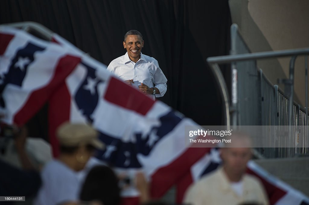 AUGUST 14 -- President Barack Obama arrives during a campaign stop at RiverLoop Amphitheatre, Waterloo Center for the Arts in Waterloo, Iowa, on Tuesday, August 14, 2012.
