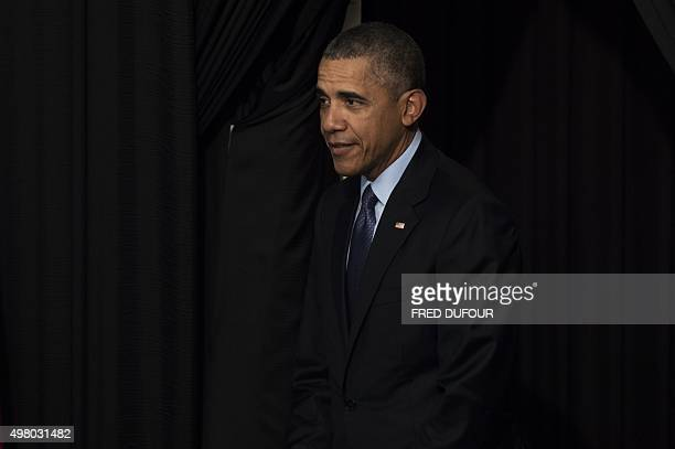US President Barack Obama arrives during a town hall with Young Southeast Asia Leaders Initiative at Taylor's University in Kuala Lumpur on November...