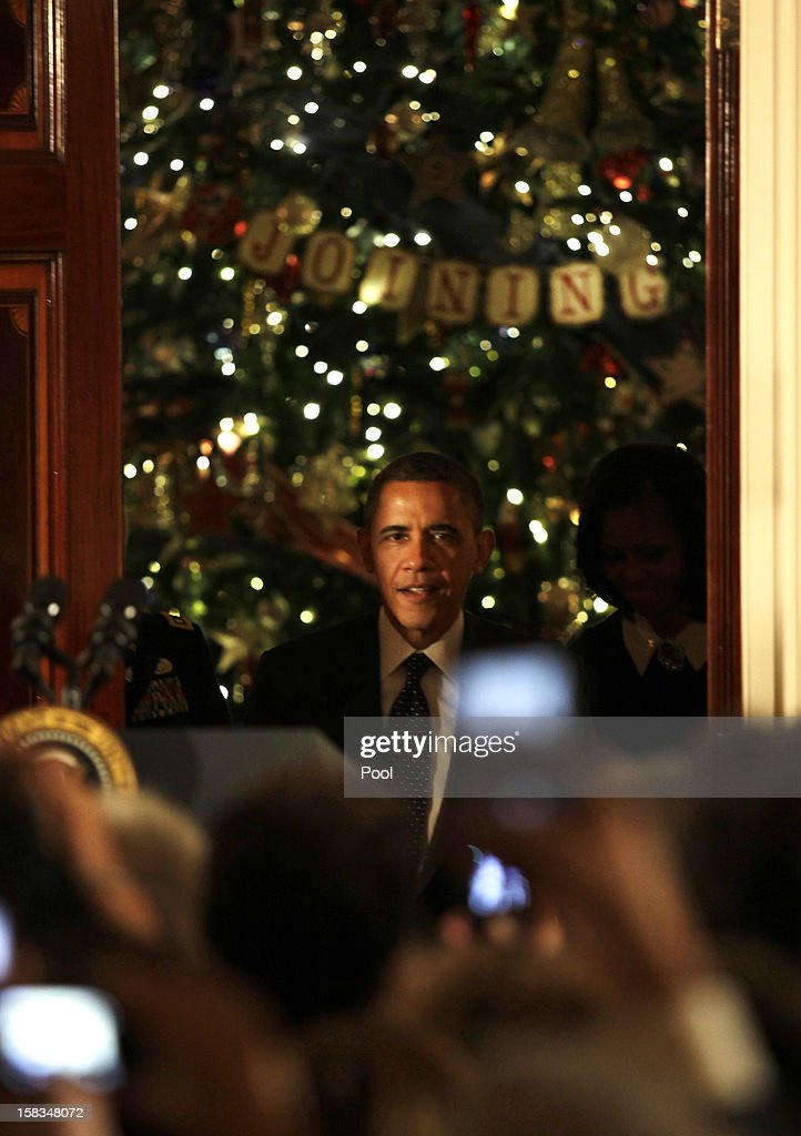 U.S. President <a gi-track='captionPersonalityLinkClicked' href=/galleries/search?phrase=Barack+Obama&family=editorial&specificpeople=203260 ng-click='$event.stopPropagation()'>Barack Obama</a> arrives for a Hanukkah reception in the Grand Foyer of the White House December 13, 2012 in Washington DC. The celebration included the lighting of candles in a 90-year-old menorah from a temple in Long Island, New York that was heavily flooded during Superstorm Sandy.