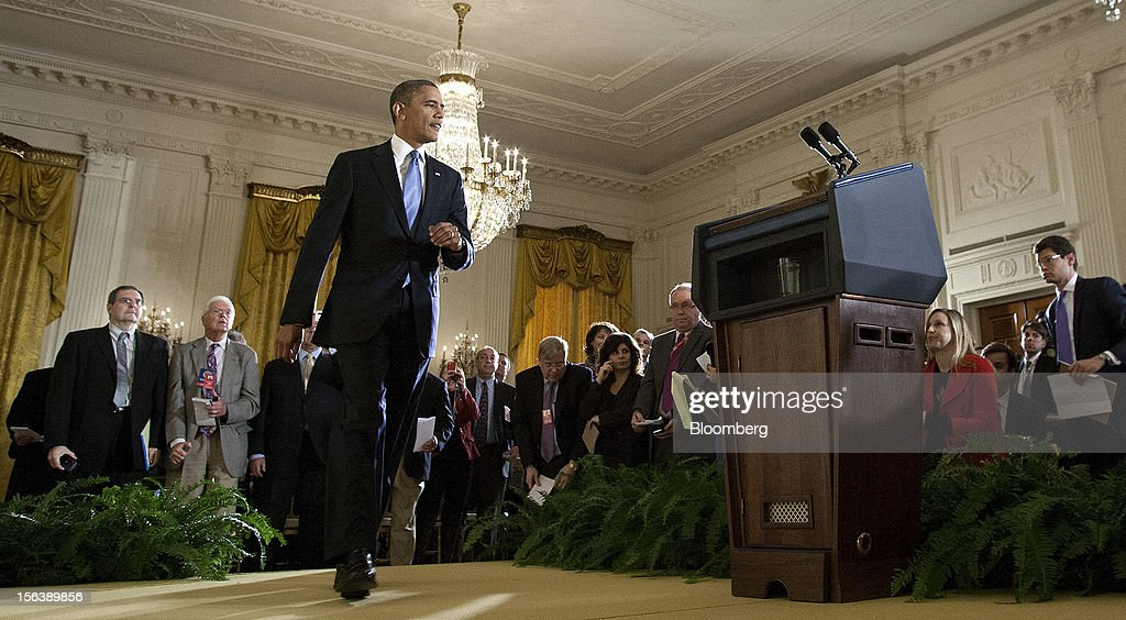 "U.S. President <a gi-track='captionPersonalityLinkClicked' href=/galleries/search?phrase=Barack+Obama&family=editorial&specificpeople=203260 ng-click='$event.stopPropagation()'>Barack Obama</a> arrives for a press conference in the East Room of the White House in Washington, D.C., U.S., on Wednesday, Nov. 14, 2012. Obama said voters sent a ""very clear message"" on Nov. 6 that they want both parties to stop bickering over politics and take the necessary steps to cut the budget deficit through a combination of tax increases for the wealthy and cuts in spending. Photographer: Joshua Roberts/Bloomberg via Getty Images"