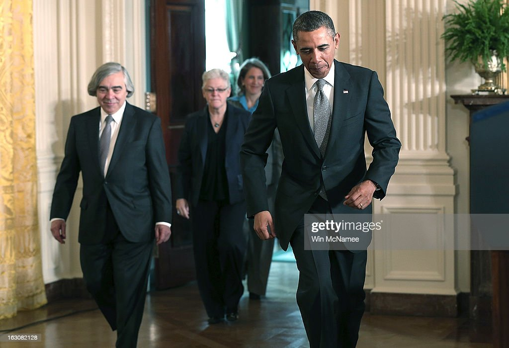 U.S. President Barack Obama (R) arrives for an event announcing the nominations of (L-R) MIT professor Ernest Moniz as Energy Secretary, Gina McCarthy, to head the Environmental Protection Agency and Sylvia Mathews Burwell, the President of the Walmart Foundation, as his budget chief, during a ceremony in the East Room of the White House March 4, 2013 in Washington, DC. The nominations will be key appointments for Obama's second term while focusing on the issues of the national budget as well as energy and climate issues.