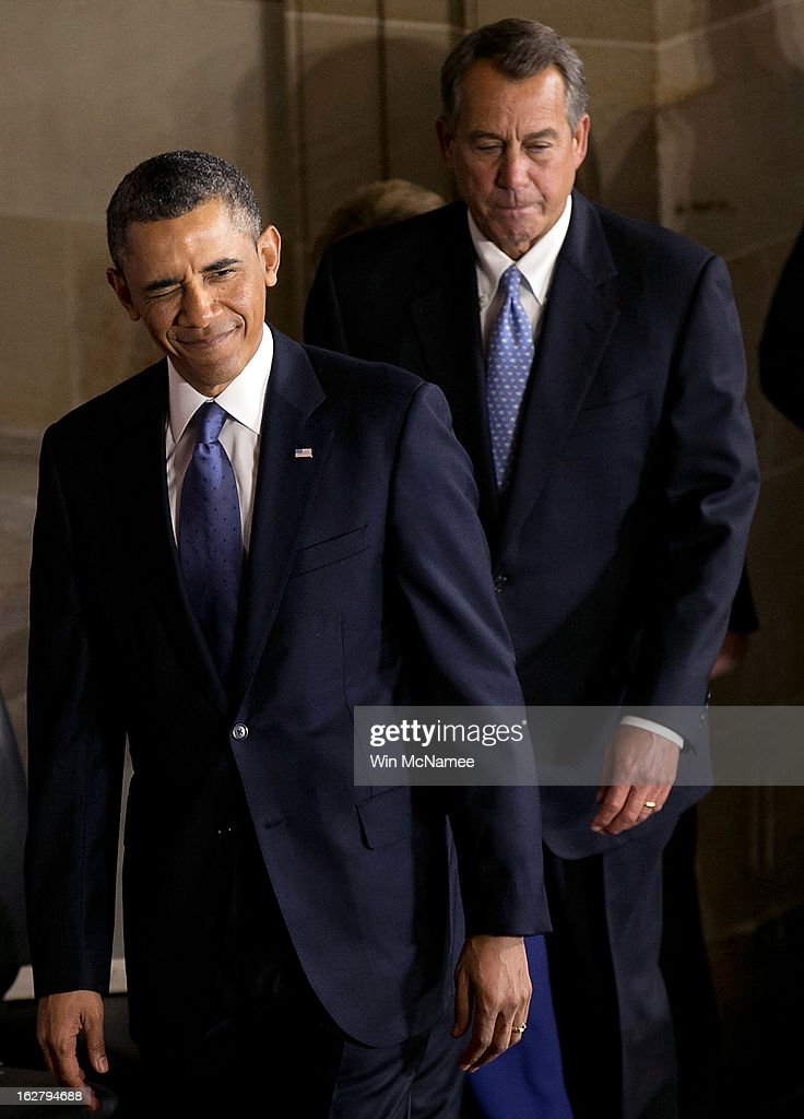 U.S. President <a gi-track='captionPersonalityLinkClicked' href=/galleries/search?phrase=Barack+Obama&family=editorial&specificpeople=203260 ng-click='$event.stopPropagation()'>Barack Obama</a> (L) arrives for an event with Speaker of the House <a gi-track='captionPersonalityLinkClicked' href=/galleries/search?phrase=John+Boehner&family=editorial&specificpeople=274752 ng-click='$event.stopPropagation()'>John Boehner</a> (R-OH) to unveil a statue honoring the late civil rights activist Rosa Parks in Statutory Hall of the U.S. Capitol February 27, 2013 in Washington, DC. Obama was joined by congressional leaders including Senate Majority Leader Harry Reid (D-NV), Senate Minority Leader Mitch McConnell (R-KY), House Speaker <a gi-track='captionPersonalityLinkClicked' href=/galleries/search?phrase=John+Boehner&family=editorial&specificpeople=274752 ng-click='$event.stopPropagation()'>John Boehner</a> (R-OH), House Minority Leader Nancy Pelosi (D-CA), and Rep. James Clyburn (D-SC).