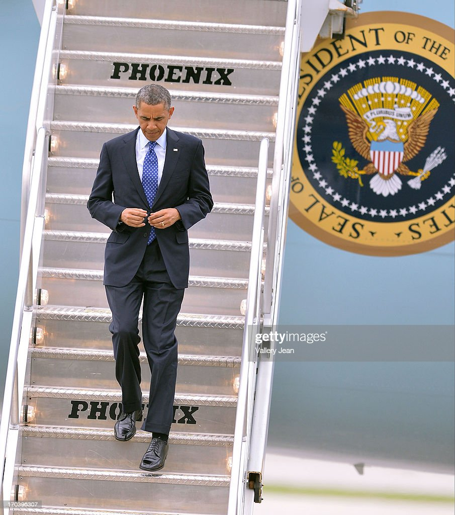 U.S. President Barack Obama arrives in Miami for a private DNC fundraising event. POTUS landed at 5:15pm at Miami International Airport on June 12, 2013 in Miami, Florida.