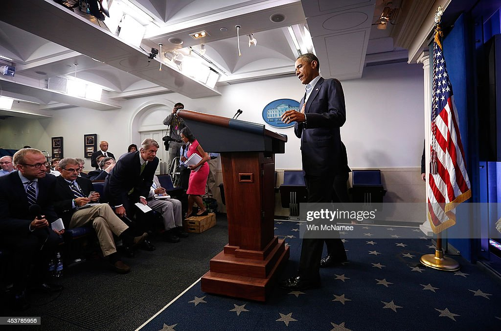 U.S. President <a gi-track='captionPersonalityLinkClicked' href=/galleries/search?phrase=Barack+Obama&family=editorial&specificpeople=203260 ng-click='$event.stopPropagation()'>Barack Obama</a> arrives in the Brady Press Briefing Room of the White House to deliver a statement and answer questions on August 18, 2014 in Washington, DC. Obama returned early from his vacation in Martha's Vineyard to hold meetings with his national security team and also with U.S. Attorney General Eric Holder in regards to the situation in Iraq and the continuing violence in Ferguson, Missouri.