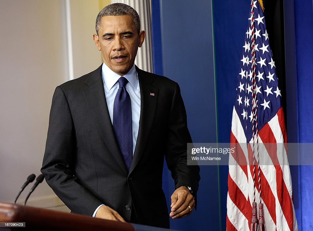 U.S. President <a gi-track='captionPersonalityLinkClicked' href=/galleries/search?phrase=Barack+Obama&family=editorial&specificpeople=203260 ng-click='$event.stopPropagation()'>Barack Obama</a> arrives in the White House Briefing Room to make a statement on the capture of Dzhokhar A. Tsarnaev on April 19, 2013 in Washington, DC. A manhunt for a suspect in the Boston Marathon bombing, Dzhokhar A. Tsarnaev, 19, ended this evening with his capture on a boat parked on a residential property in Watertown, Massachusetts. His brother Tamerlan Tsarnaev, 26, the other suspect, was shot and killed by police early this morning after a car chase and shootout with police. The two men are suspects in the bombings at the Boston Marathon on April 15 that killed three people and wounded at least 170.