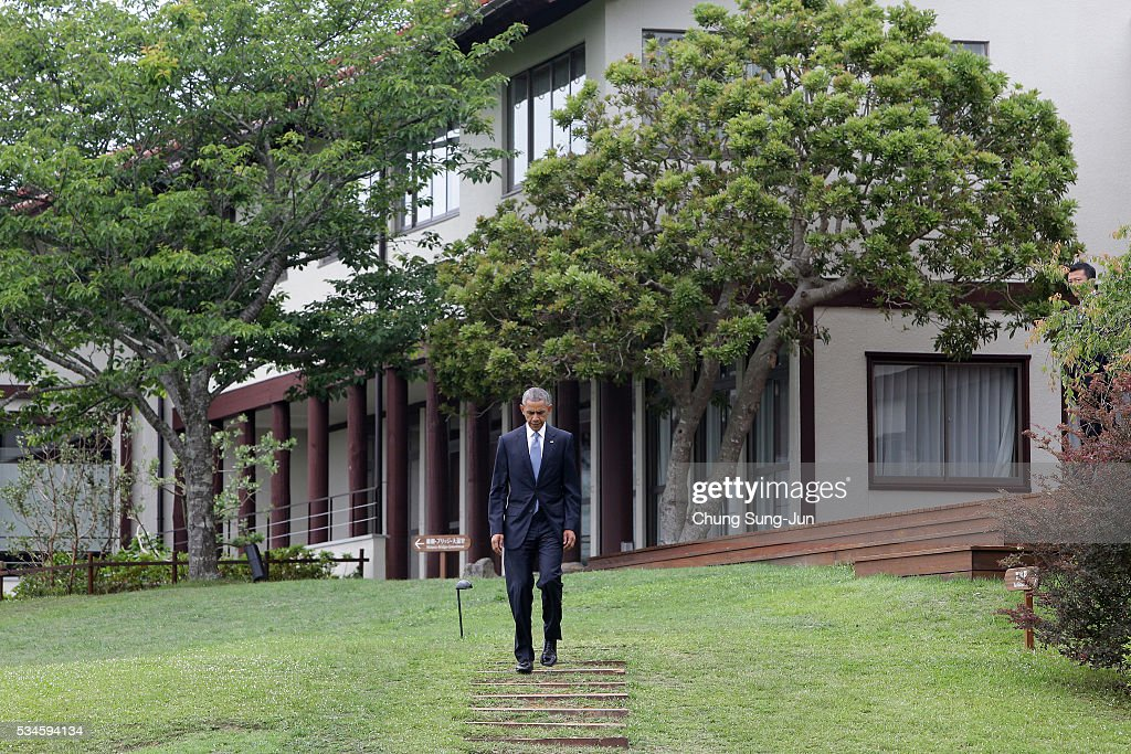 U.S. President <a gi-track='captionPersonalityLinkClicked' href=/galleries/search?phrase=Barack+Obama&family=editorial&specificpeople=203260 ng-click='$event.stopPropagation()'>Barack Obama</a> arrives last to the 'Outreach Session' family photo session on May 27, 2016 in Kashikojima, Japan. In the two-day summit, the G7 leaders are scheduled to discuss the pressing global issues including counter-terrorism, energy policy, and sustainable development.