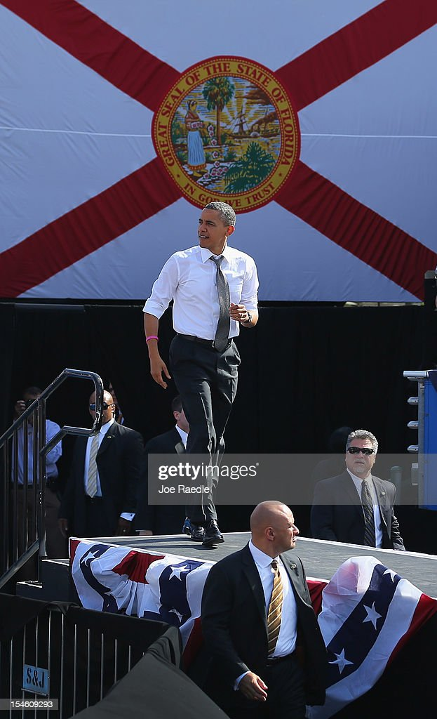 U.S. President <a gi-track='captionPersonalityLinkClicked' href=/galleries/search?phrase=Barack+Obama&family=editorial&specificpeople=203260 ng-click='$event.stopPropagation()'>Barack Obama</a> arrives on stage during a campaign rally at the Delray Beach Tennis Center on October 23, 2012 in Delray Beach, Florida. President Obama continues to campaign across America.
