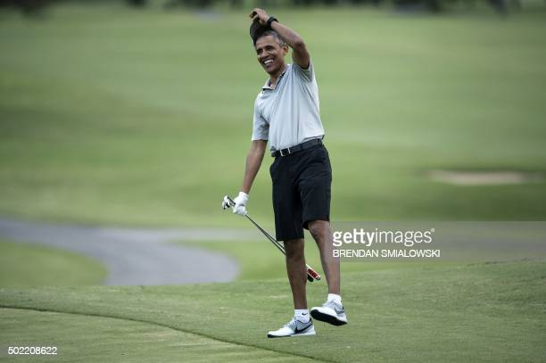 President Barack Obama arrives on the 18th hole of the MidPacific Country Club's golf course December 21 2015 in Kailua Hawaii Obama and the First...