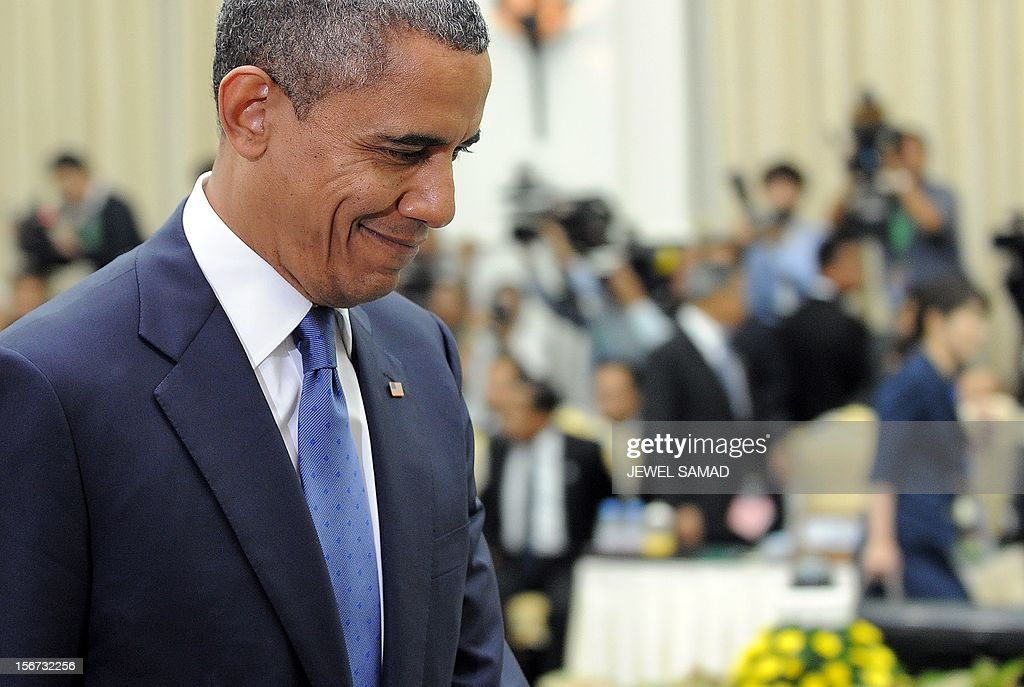US President Barack Obama arrives to attend an East Asian Summit Plenary Session at the Peace Palace in Phnom Penh on November 20, 2012. During the two-day East Asia Summit, Obama was scheduled to hold talks with the leaders of the 10-member Association of Southeast Asian Nations (ASEAN) along with Chinese Premier Wen Jiabao and Japan's Premier Yoshihiko Noda. AFP PHOTO Jewel Samad
