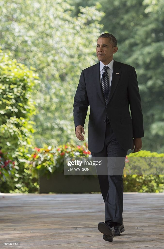 US President <a gi-track='captionPersonalityLinkClicked' href=/galleries/search?phrase=Barack+Obama&family=editorial&specificpeople=203260 ng-click='$event.stopPropagation()'>Barack Obama</a> arrives to deliver a statement on American troops in Afghanistan from the Rose Garden at the White House in Washington, DC, May 27, 2014. AFP PHOTO / Jim WATSON