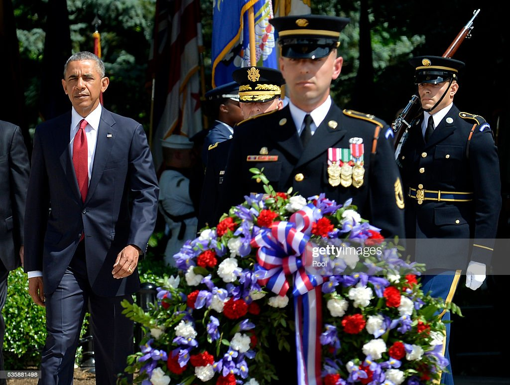 President <a gi-track='captionPersonalityLinkClicked' href=/galleries/search?phrase=Barack+Obama&family=editorial&specificpeople=203260 ng-click='$event.stopPropagation()'>Barack Obama</a> arrives to lay a wreath at the Tomb of the Unknown Soldier at Arlington National Cemetery on May 30, 2016 in Arlington, Virginia. Obama paid tribute to the nation's fallen military service members.