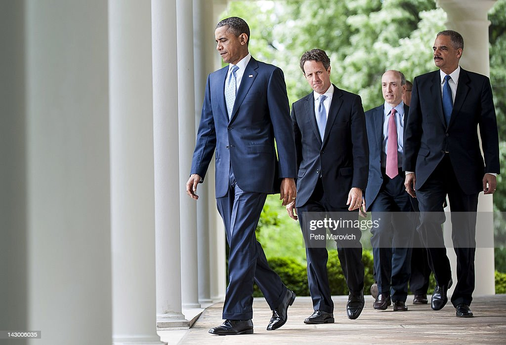 U.S. President <a gi-track='captionPersonalityLinkClicked' href=/galleries/search?phrase=Barack+Obama&family=editorial&specificpeople=203260 ng-click='$event.stopPropagation()'>Barack Obama</a> arrives to speak about the oil markets followed by U.S. Secretary of the Treasury <a gi-track='captionPersonalityLinkClicked' href=/galleries/search?phrase=Timothy+Geithner&family=editorial&specificpeople=5087853 ng-click='$event.stopPropagation()'>Timothy Geithner</a>, Commodity Futures Trading Commission Chairman Gary Gensler and U.S. Attorney General <a gi-track='captionPersonalityLinkClicked' href=/galleries/search?phrase=Eric+Holder&family=editorial&specificpeople=1060367 ng-click='$event.stopPropagation()'>Eric Holder</a> in the Rose Garden of the White House on April 17, 2012 in Washington, DC. Obama announced a plan to increase oversight and crack down on manipulation of the oil markets.