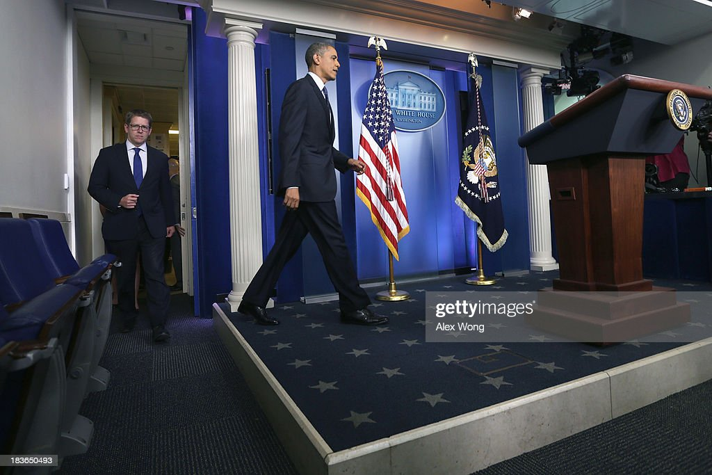 U.S. President <a gi-track='captionPersonalityLinkClicked' href=/galleries/search?phrase=Barack+Obama&family=editorial&specificpeople=203260 ng-click='$event.stopPropagation()'>Barack Obama</a> (C) arrives to speak during a press conference with Press Secretary Jay Carney (L) in the Brady Press Briefing Room of the White House on October 8, 2013 in Washington, DC. Now in the eighth day of a government shutdown, Obama and his Democratic allies have reiterated to House Speaker John Boehner (R-OH) that they will negotiate but only after Republicans vote to approve a clean extension of government spending and authorize an increase in the debt limit.