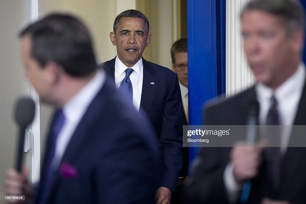 U.S. President Barack Obama arrives to speak in the Brady Press Briefing Room at the White House in Washington, D.C., U.S., on Friday, Dec. 28, 2012. Obama is seeking an up-or-down vote on his proposal to extend tax cuts for annual income up to $250,000, absent a counteroffer from congressional leaders, an official familiar with today's budget talks said. Photographer: Andrew Harrer/Bloomberg via Getty Images