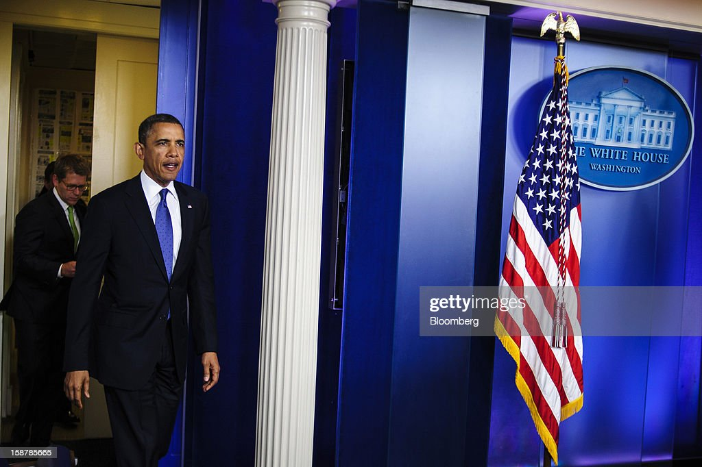 U.S. President <a gi-track='captionPersonalityLinkClicked' href=/galleries/search?phrase=Barack+Obama&family=editorial&specificpeople=203260 ng-click='$event.stopPropagation()'>Barack Obama</a> arrives to speak in the Brady Press Briefing Room at the White House in Washington, D.C., U.S., on Friday, Dec. 28, 2012. Obama said he's 'modestly optimistic' Congress can pass a bill to avert more than $600 billion in tax increases and spending cuts set to start Jan. 1. Photographer: Pete Marovich/Bloomberg via Getty Images