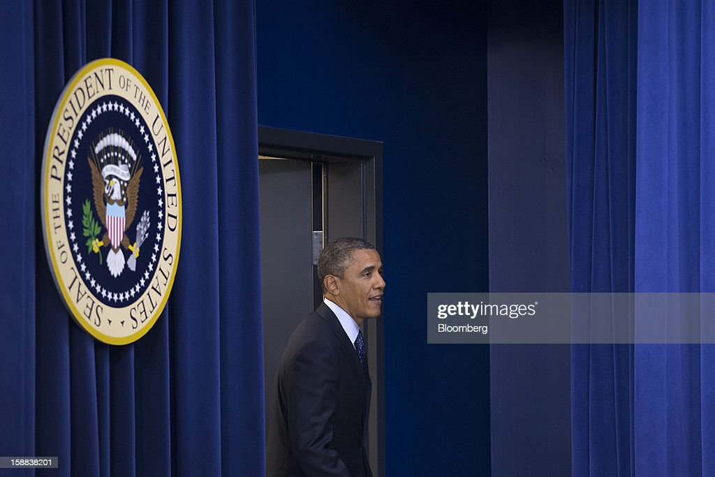 U.S. President Barack Obama arrives to speak in the South Court Auditorium of the Eisenhower Executive Building next to the White House in Washington, D.C., U.S., on Monday, Dec. 31, 2012. Obama, backed by a group of of people described by the White House as 'middle class Americans,' said an agreement on the so-called fiscal cliff is 'within sight,' but 'it's not done.' Photographer: Andrew Harrer/Bloomberg via Getty Images