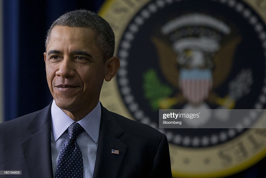 U.S. President <a gi-track='captionPersonalityLinkClicked' href=/galleries/search?phrase=Barack+Obama&family=editorial&specificpeople=203260 ng-click='$event.stopPropagation()'>Barack Obama</a> arrives to speak in the South Court Auditorium of the Eisenhower Executive Building next to the White House in Washington, D.C., U.S., on Tuesday, Feb. 19, 2013. Obama stepped up pressure on Congress to avert 'brutal' automatic $1.2 trillion in budget cuts set to kick in March 1, saying it would harm the economy and curtail vital services. Photographer: Andrew Harrer/Bloomberg via Getty Images