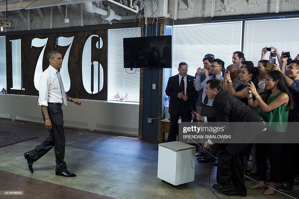 US President Barack Obama arrives to speak with people at 1776, a tech startup hub, on July 3, 2014 in Washington, DC. Obama spoke about job growth as employers added 288,000 jobs in June, putting the unemployment rate to 6.1 percent, the lowest since September 2008, Labor Department data showed Thursday. AFP Photo/Brendan SMIALOWSKI