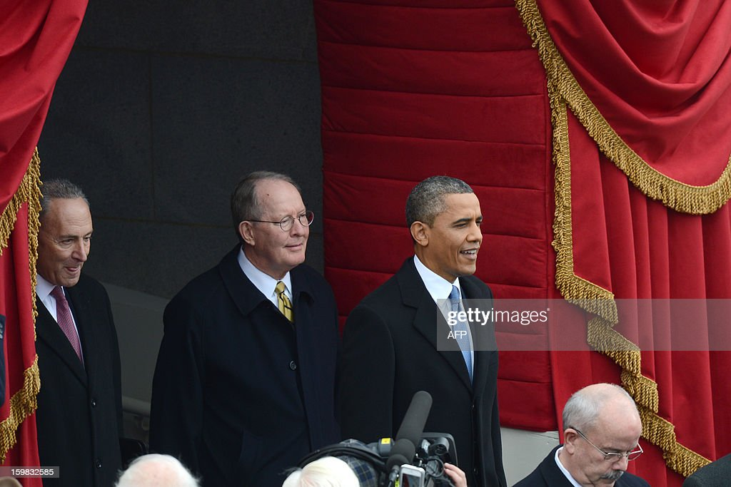 US President Barack Obama arrives to take the oath of office during the 57th Presidential Inauguration ceremonial swearing-in at the US Capitol on January 21, 2013 in Washington, DC. The oath is to be administered by Chief Justice John Roberts. Accomapnying the President are Senators Lamar Alexander, R-TN, and Charles Schumer, D-NY. AFP PHOTO / Saul LOEB