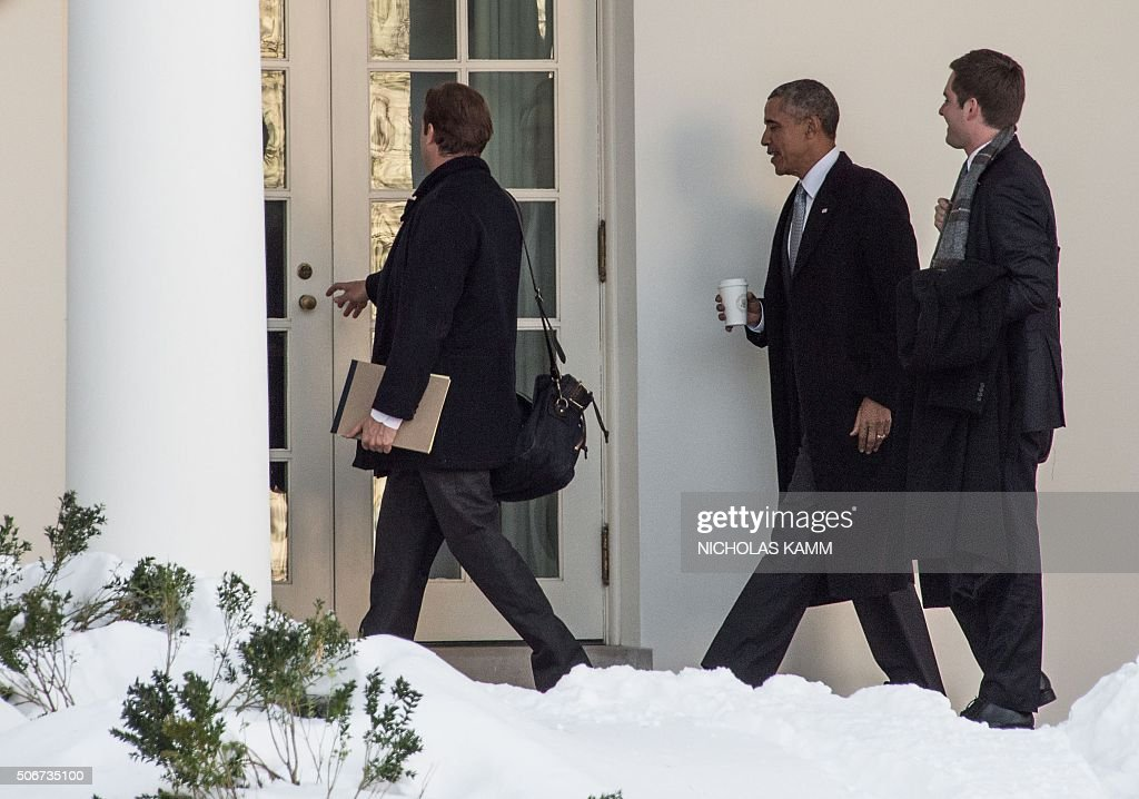 us president barack obama arrives to the oval office at the white house with special assistants to the president and deputy directors of the white house barack obama enters oval