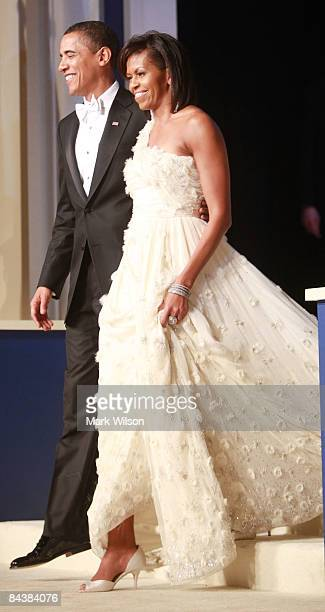 President Barack Obama arrives with his wife Michelle Obama at the MidAtlantic Inaugural Ball at the Washington Convention Center on January 20 2009...