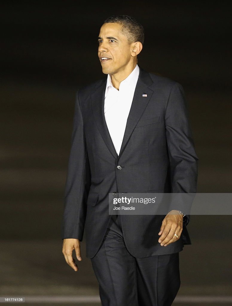 President <a gi-track='captionPersonalityLinkClicked' href=/galleries/search?phrase=Barack+Obama&family=editorial&specificpeople=203260 ng-click='$event.stopPropagation()'>Barack Obama</a> as he arrives at the Palm Beach International Airport on February 15, 2013 in West Palm Beach, Florida. President Obama plans to spend the Presidents Day holiday weekend in the area.