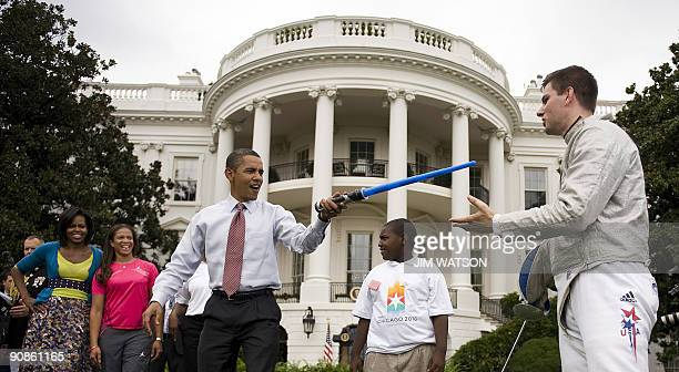 US President Barack Obama attacks USA Fencer Tim Morehouse with a lightsaber during an event on Olympics Paralympics and youth sport on the South...