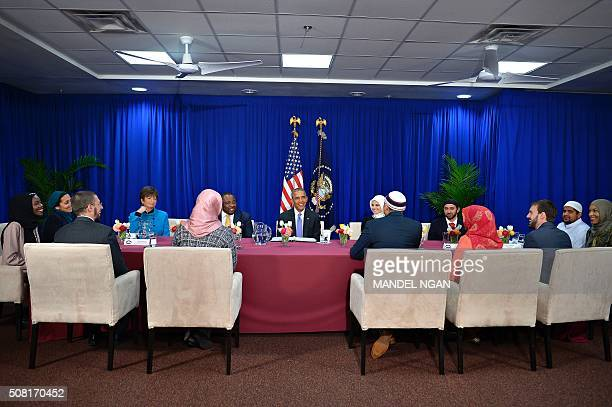 US President Barack Obama attends a roundtable discussion with members of the Muslim community while visiting the Islamic Society of Baltimore...