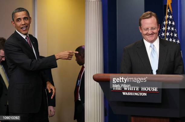 S President Barack Obama attends outgoing White House Press Secretary Robert Gibbs' last daily press briefing February 11 2011 at the White House in...