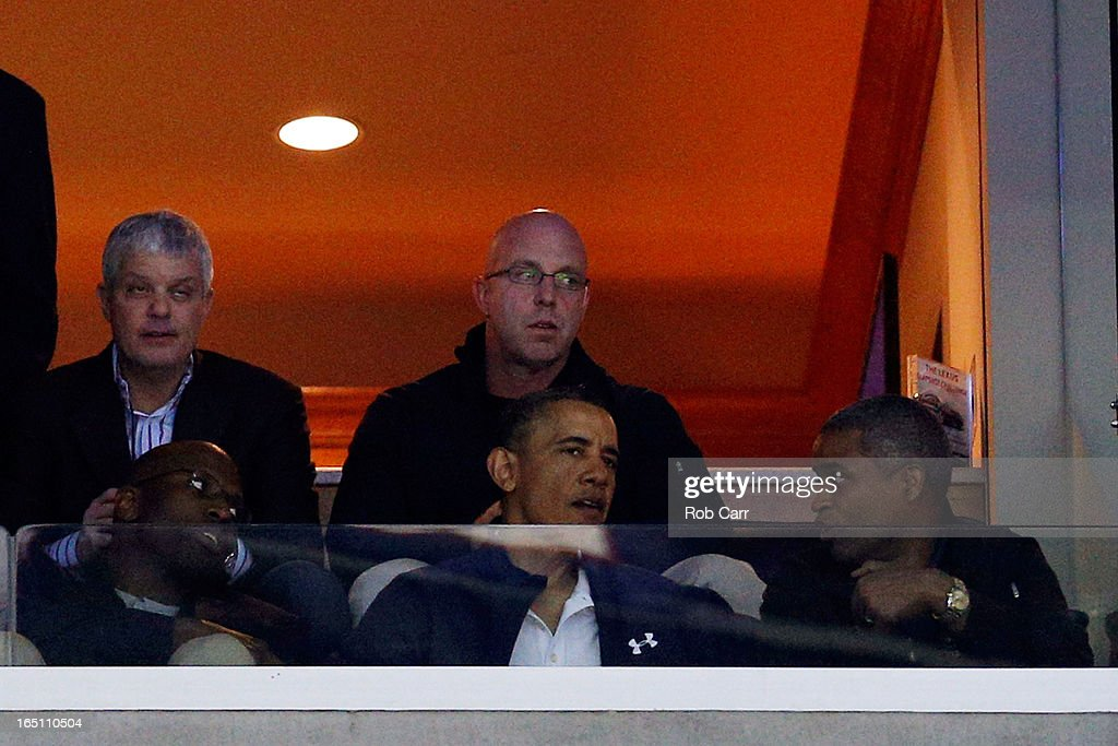 U.S. President Barack Obama attends the East Regional Round Final of the 2013 NCAA Men's Basketball Tournament between the Syracuse Orange and the Marquette Golden Eagles at Verizon Center on March 30, 2013 in Washington, DC.