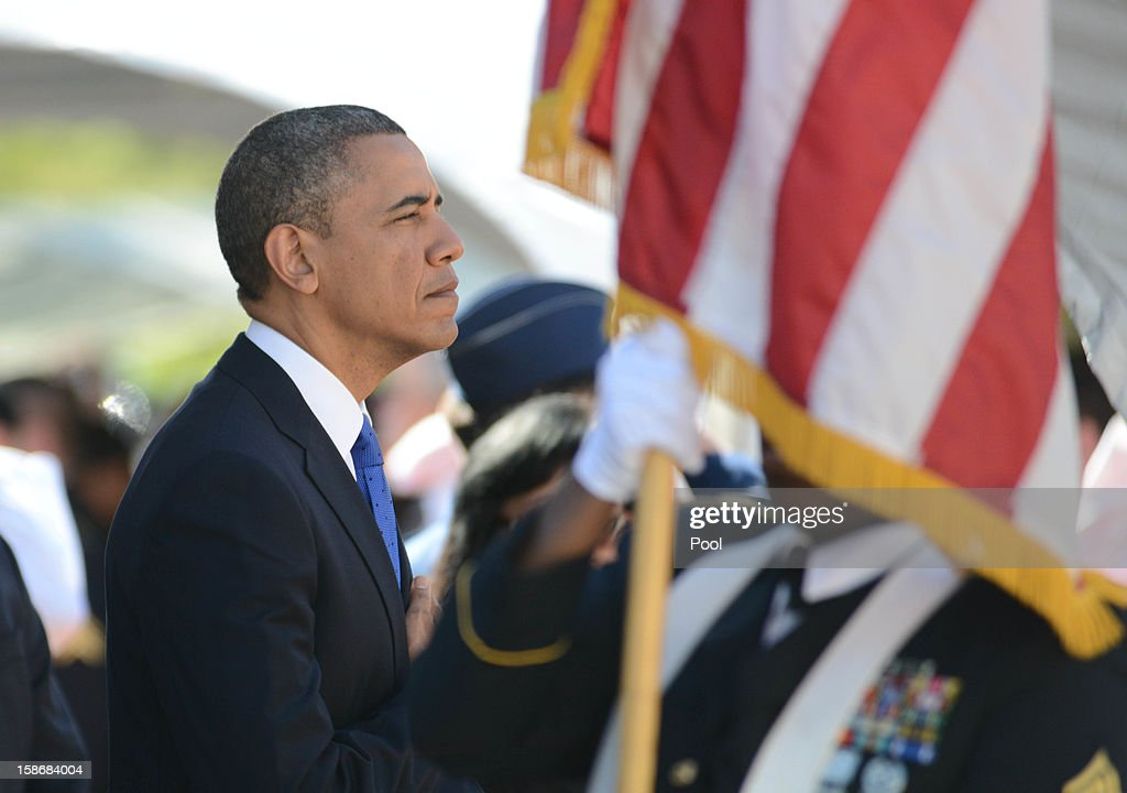 U.S. President <a gi-track='captionPersonalityLinkClicked' href=/galleries/search?phrase=Barack+Obama&family=editorial&specificpeople=203260 ng-click='$event.stopPropagation()'>Barack Obama</a> attends the funeral services for the late Senator Daniel Inouye at the National Memorial Cemetery of the Pacific December 23, 2012 in Honolulu, Hawaii. Senator Inouye was a Medal of Honor recipient and a United States Senator since 1963.