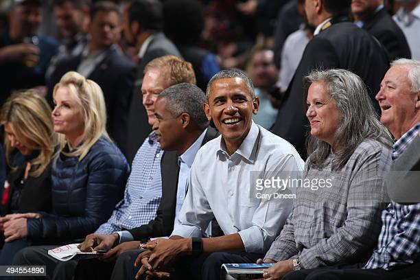 S President Barack Obama attends the game between the Chicago Bulls and the Cleveland Cavaliers on October 27 2015 at the United Center in Chicago...