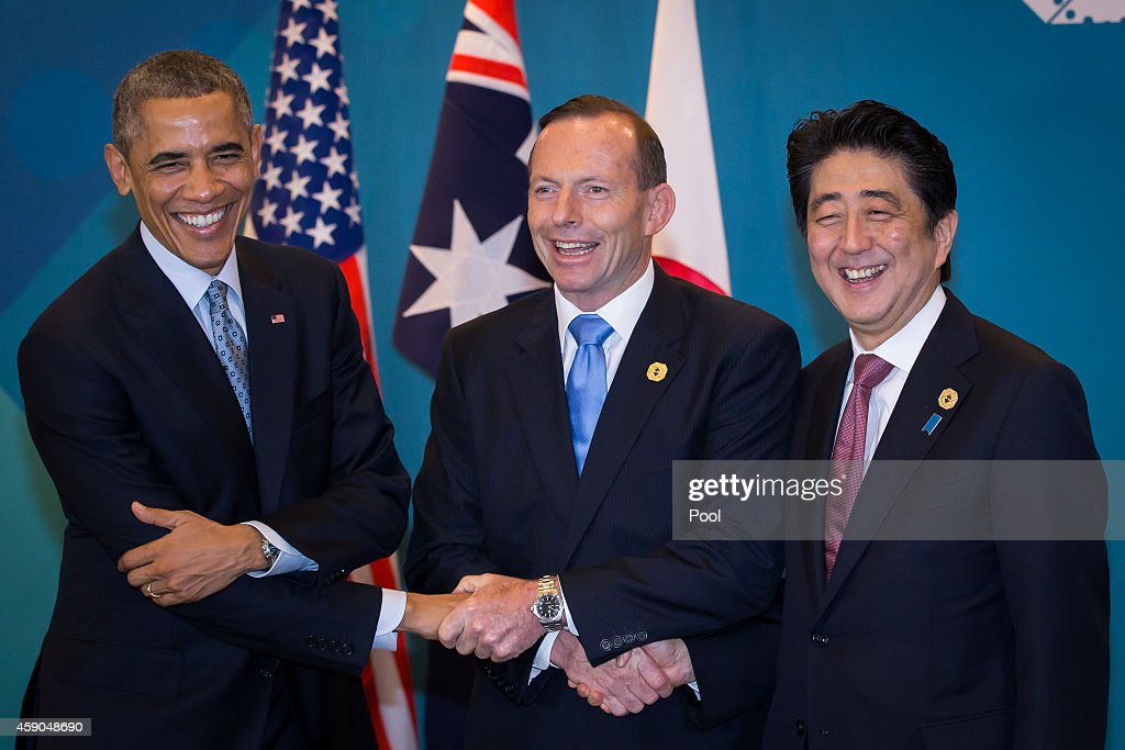 U.S. President <a gi-track='captionPersonalityLinkClicked' href=/galleries/search?phrase=Barack+Obama&family=editorial&specificpeople=203260 ng-click='$event.stopPropagation()'>Barack Obama</a>, Australian Prime Minister <a gi-track='captionPersonalityLinkClicked' href=/galleries/search?phrase=Tony+Abbott&family=editorial&specificpeople=220956 ng-click='$event.stopPropagation()'>Tony Abbott</a>, and Japan's Prime Minister <a gi-track='captionPersonalityLinkClicked' href=/galleries/search?phrase=Shinzo+Abe&family=editorial&specificpeople=559017 ng-click='$event.stopPropagation()'>Shinzo Abe</a> shake hands during a trilateral meeting at the G20 Summit on November 16, 2014 in Brisbane, Australia. World leaders have gathered in Brisbane for the annual G20 Summit and are expected to discuss economic growth, free trade and climate change as well as pressing issues including the situation in Ukraine and the Ebola crisis.