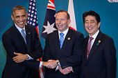 US President Barack Obama Australian Prime Minister Tony Abbott and Japan's Prime Minister Shinzo Abe shake hands during a trilateral meeting at the...