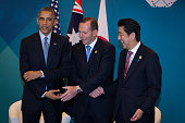 US President Barack Obama Australian Prime Minister Tony Abbott and Japan's Prime Minister Shinzo Abe meet during a trilateral meeting at the G20...