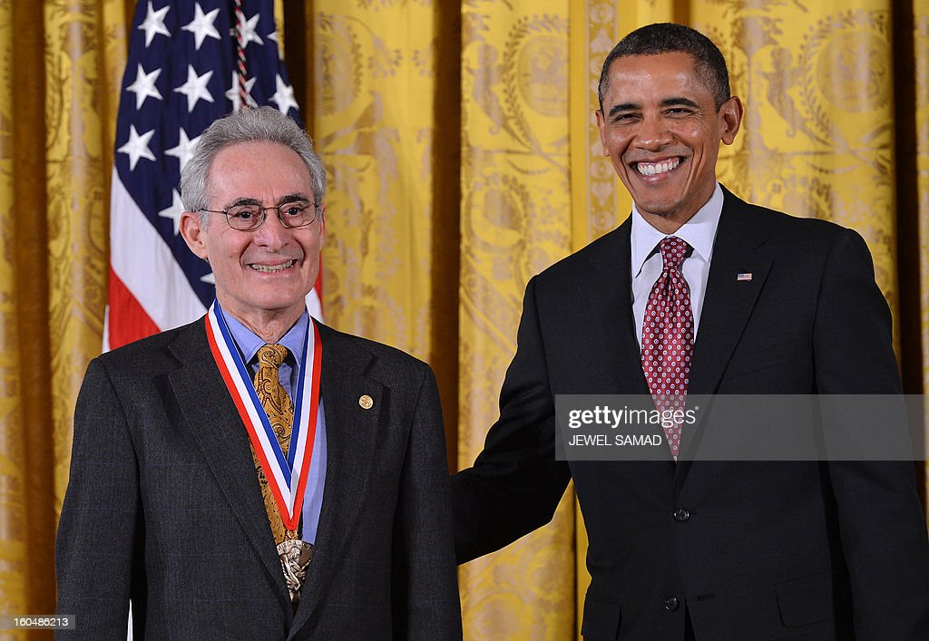 US President Barack Obama awards Barry Mazur from Harvard University with the National Medal of Science, the highest honors bestowed by the US upon scientists, engineers, and inventors, during a ceremony in the East Room at the White House in Washington, DC, on February 1, 2013. AFP PHOTO/Jewel Samad