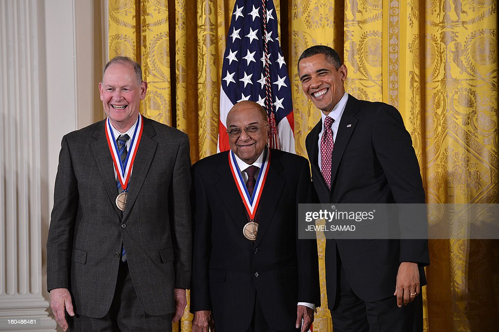US President Barack Obama awards James Wynne (C) and Samuel Blum (L), IBM Corporation, NY, with the National Medal of Technology and Innovation, the highest honors bestowed by the US upon scientists, engineers, and inventors, during a ceremony in the East Room at the White House in Washington, DC, on February 1, 2013. AFP PHOTO/Jewel Samad