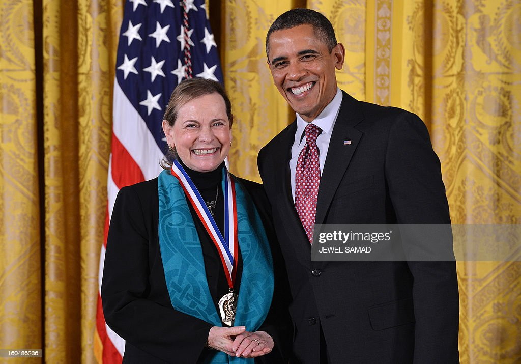 US President Barack Obama awards Lucy Shapiro from Stanford University School of Medicine with the National Medal of Science, the highest honors bestowed by US upon scientists, engineers, and inventors, during a ceremony in the East Room at the White House in Washington, DC, on February 1, 2013. AFP PHOTO/Jewel Samad
