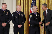 S President Barack Obama awards Santa Monica Police Department Officers Jason Salas and Robert Sparks and Captain Raymond Bottenfield with the...