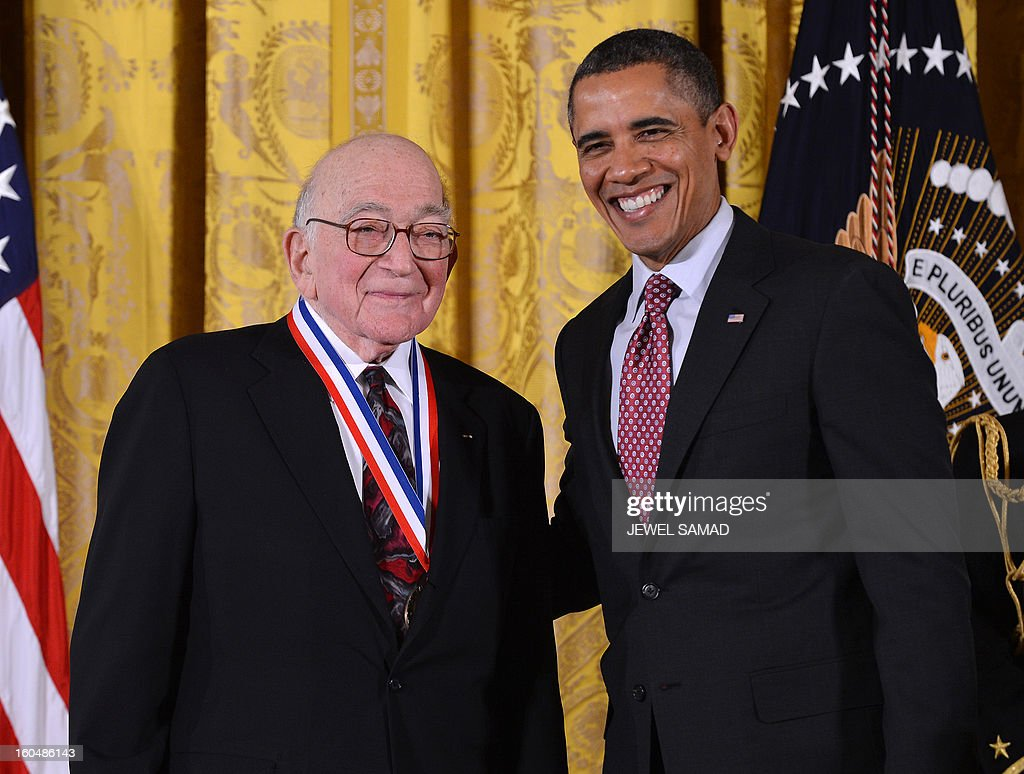 US President Barack Obama awards Sidney Drell from Stanford University, California, with the National Medal of Science, the highest honors bestowed by the US upon scientists, engineers, and inventors, during a ceremony in the East Room at the White House in Washington, DC, on February 1, 2013. AFP PHOTO/Jewel Samad