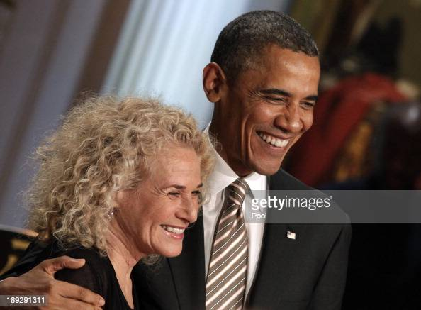 S President Barack Obama awards singersongwriter Carole King the 2013 Library of Congress Gershwin Prize for Popular Song during a concert at the...