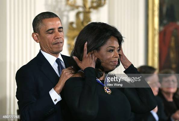 S President Barack Obama awards the Presidential Medal of Freedom to Oprah Winfrey in the East Room at the White House on November 20 2013 in...