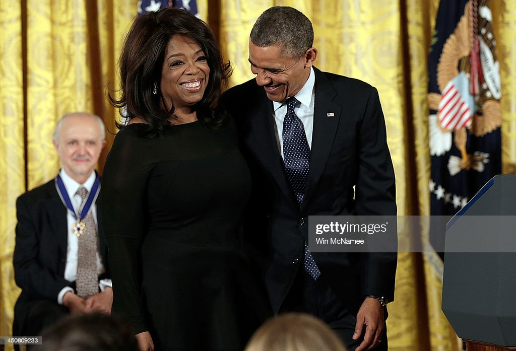 U.S. President <a gi-track='captionPersonalityLinkClicked' href=/galleries/search?phrase=Barack+Obama&family=editorial&specificpeople=203260 ng-click='$event.stopPropagation()'>Barack Obama</a> (R) awards the Presidential Medal of Freedom to <a gi-track='captionPersonalityLinkClicked' href=/galleries/search?phrase=Oprah+Winfrey&family=editorial&specificpeople=171750 ng-click='$event.stopPropagation()'>Oprah Winfrey</a> (C) in the East Room at the White House on November 20, 2013 in Washington, DC. The Presidential Medal of Freedom is the nation's highest civilian honor, presented to individuals who have made meritorious contributions to the security or national interests of the United States, to world peace, or to cultural or other significant public or private endeavors.